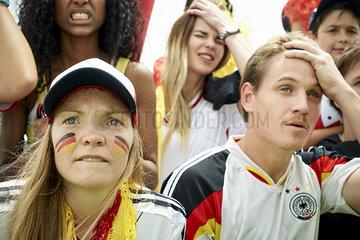 German football fans watching football match