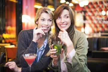 Women having cocktail in bar