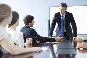 Business associates discuss matter during meeting