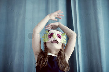 Llittle girl wearing mask