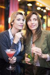 Women having cocktail at bar