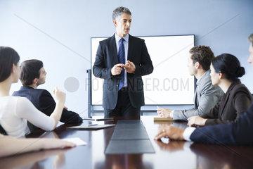 Executive making presentation at business meeting