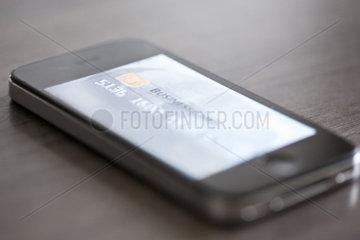 Smartphone displaying image of credit card