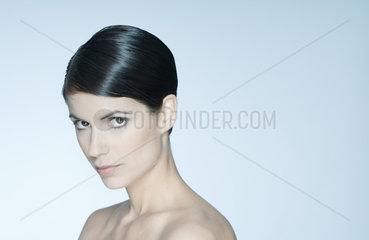 Woman with short hair  bare shoulders  portrait