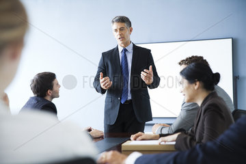 Corporate trainer leading training session