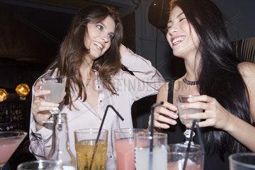 Women sharing laughs in nightclub