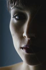 Woman's face in shadow  close-up