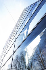 Facade of modern skyscraper  La Defense  Paris  France