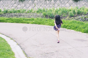 Carefree little girl  rear view