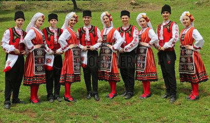 Vratsa  Bulgaria - June 24  2018: People in traditional authentic folklore costume a meadow near Vratsa  Bulgaria