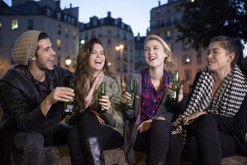 Friends having beers together outdoors
