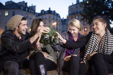 Friends celebrating together outdoors