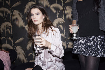 Women in club with cocktails