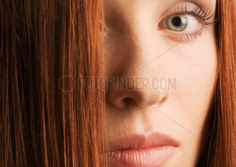 Woman's face and red hair  portrait