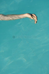 Woman's arm floating in pool