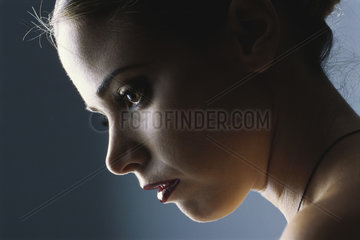 Woman looking down  profile  close-up