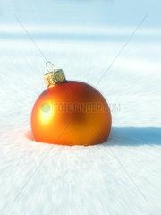 Orange Christmas Ball Ornament in the snow - Christbaumkugel