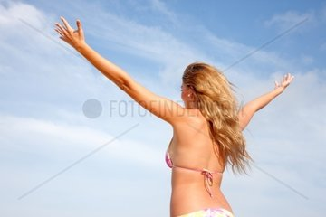beautiful woman enjoying freedom at the beach