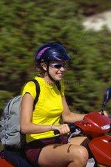 Spanien  Ibiza  junge Frau auf Motorroller