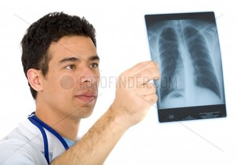 doctor looking at an xray of the thoraxisolated over a white background