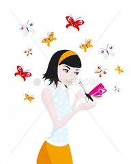 Frau mit Schmetterling auf der Hand