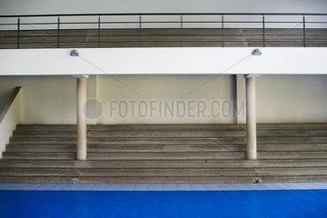 Bleachers in empty gymnasium