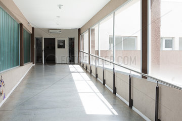 Sunlight shining through windows in empty corridor