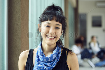Female college student smiling cheerfully  portrait
