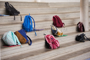 Backpacks left on stairs