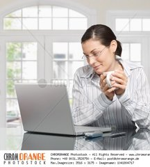 Young woman looks at her laptop computer