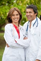 couple of doctors standing outdoors smiling