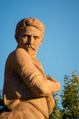 A stone statue of Stepan Shahumyan in Yerevan  Armenia.