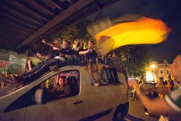 Men and women celebrate football world championship