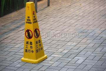 Hong Kong  China  Warnhinweis  Pestizide werden versprueht