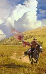 Western Reiter brennendes Haus Flucht