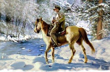 Western Reiter im Winterwald