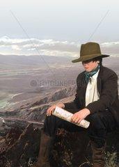 Junge mit Hut Lanschaft Praerie Landkarte Orientierung