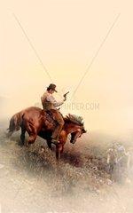 Western Reiter Maenner Pferd Angriff