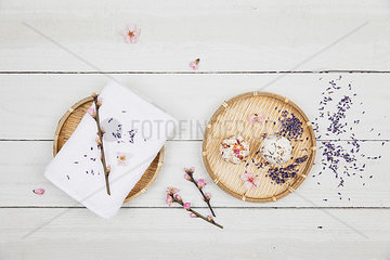 Blossom soap balls on bamboo bowl with towel  cherry and lavender blossom