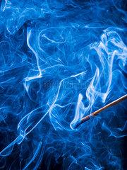 Smoke of blown out matchstick