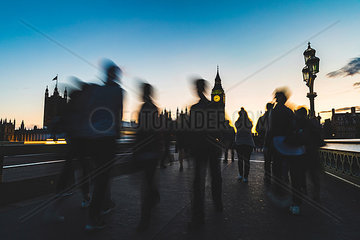 UK  London  silhouette of people on Westminster bridge with Big Ben in background at sunset