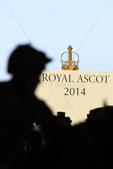 Royal Ascot  Silhouetted jockey in front of the shield Royal Ascot 2014