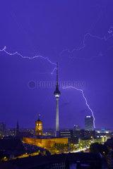 Berlin  Deutschland  Gewitter ueber dem Alexanderplatz bei Daemmerung