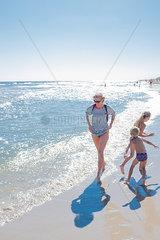 Poland  Gdansk Bay  woman strolling on the beach