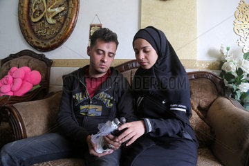 MIDEAST-GAZA-PALESTINIAN COUPLE-DESTROYED HOUSE