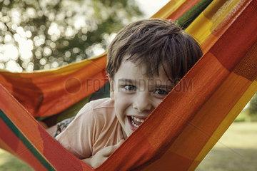 Boy lying in hammock  portrait