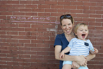 Mother and toddler son together outdoors  portrait