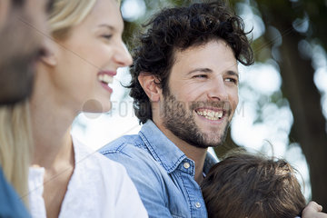 Man enjoying afternoon with friends and family
