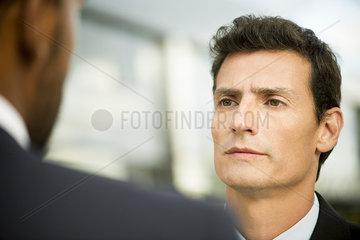 Businessman having serious conversation with colleague