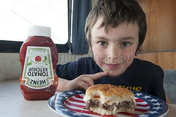Boy with hamburger  portrait
